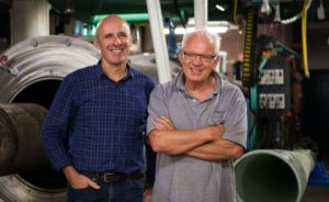 Professor Richard Morgan (right) at the UQ Centre of Hypersonics ground-testing facility, with colleague Professor Michael Smart.