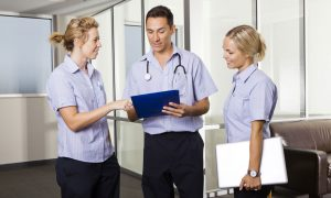 doctor with nurses stock image