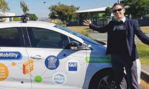 Michael Milford with CHAD vehicle. Image courtesy of iMOVE CRC