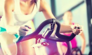 woman uses exercise bike stock image