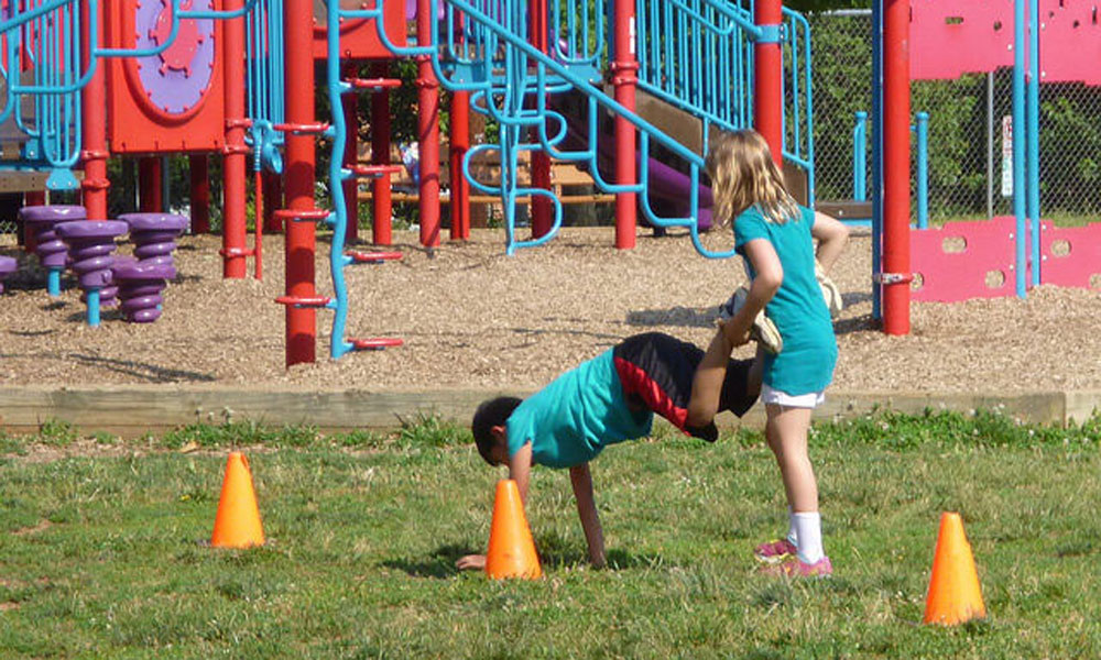 children playing outside stock image