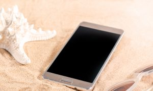 phone sand beach stock image
