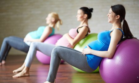 pregnant women exercise stock image