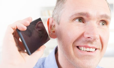 hearing aid smartphone stock image